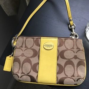 Coach signature wristlet with yellow accent